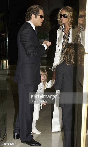 Elle Macpherson leaves the Hotel Hassler with her partner Arpad Busson and their sons Flynn and Aurelius to attend the christening of Aurelius at...