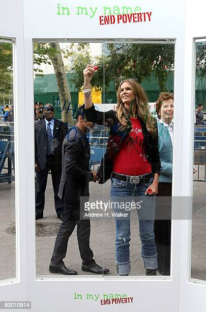 Elle Macpherson signs her name at the launch of the In My Name global campaign at Dag Hammarskjold Plaza on September 25 2008 in New York City