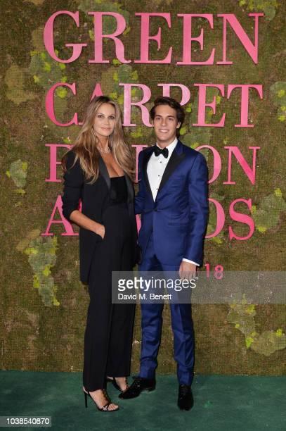Elle Macpherson wearing Roberto Cavalli and Flynn Busson attend The Green Carpet Fashion Awards Italia 2018 at Teatro Alla Scala on September 23 2018...