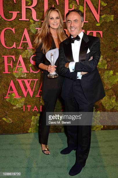 Elle Macpherson winner of The Wellness Award and Nerio Alessandri pose backstage at The Green Carpet Fashion Awards Italia 2018 at Teatro Alla Scala...