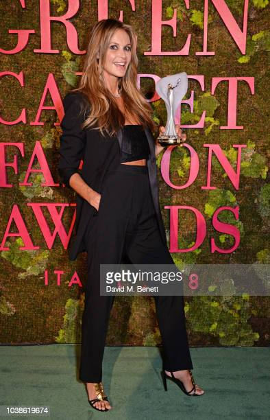 Elle Macpherson winner of The Wellness Award poses backstage at The Green Carpet Fashion Awards Italia 2018 at Teatro Alla Scala on September 23 2018...