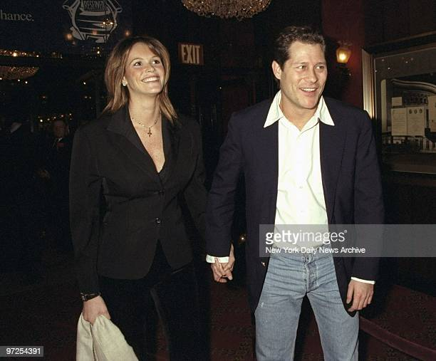 Elle Macpherson with her boyfriend attending premiere of the movie 'The Man in the Iron Mask' at the Ziegfeld Theater