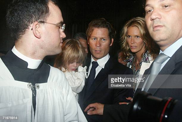 Elle Macpherson with her partner Arpad Busson and their sons Flynn and Aurelius arrive to attend the christening of Aurelius at Basilca Santa Maria...