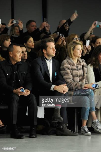 Elle magazine creative director Joe Zee Derek Blasberg and Lizzie Tisch attend the Rodarte fashion show during MercedesBenz Fashion Week Fall 2014 at...