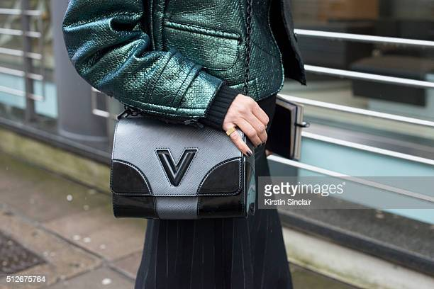 Elle magazine fashion director Anne Marie Curtis wears a Carven jacket Barbara Casasola skirt and Louis Vuitton bag on day 4 during London Fashion...