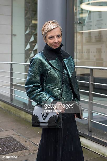 Elle magazine fashion director Anne Marie Curtis wears a Margaret Howell sweater Carven jacket Barbara Casasola skirt and Louis Vuitton bag on day 4...