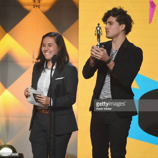 Elle Mills and Anthony Padilla speak onstage during The 8th Annual Streamy Awards at The Beverly Hilton Hotel on October 22 2018 in Beverly Hills...
