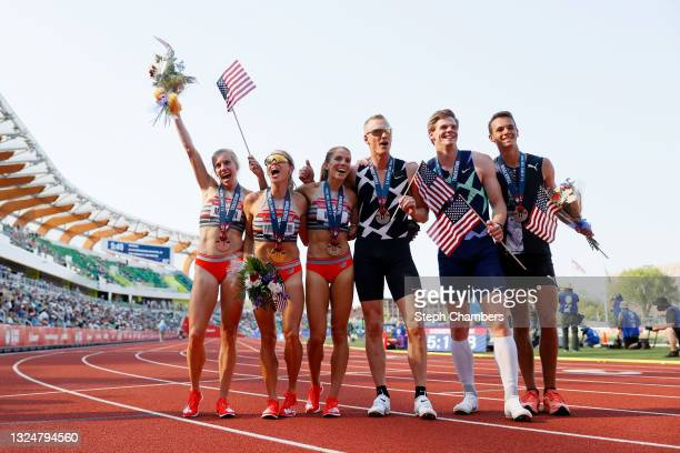 Elle Purrier St. Pierre, first, Cory McGee, second, and Heather MacLean, third, celebrate after the Women's 1500 Meters Final with Chris Nilsen,...