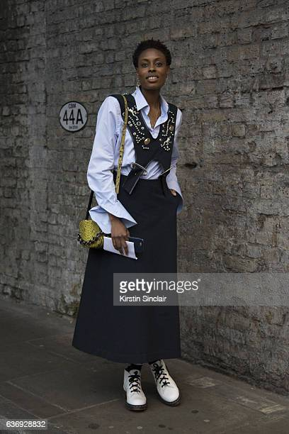 Elle UK accessories editor Donna Wallace wears a Toga dress Gant shirt Dr Martens boots Amanda wakely bag and Maria Black earrings on day 2 of London...