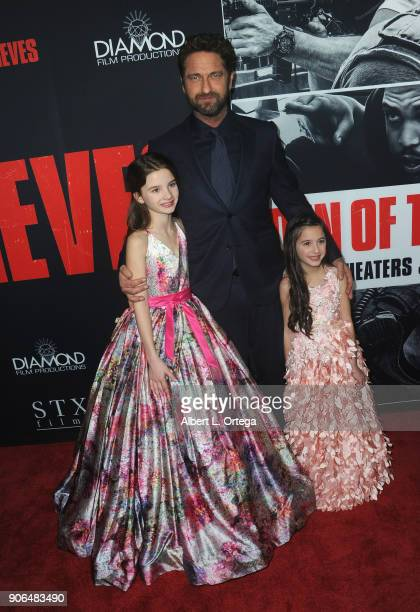Elle Whitfield Gerard Butler and Madelyn Lazar arrive for the Premiere Of STX Films' 'Den Of Thieves' held at Regal LA Live Stadium 14 on January 17...