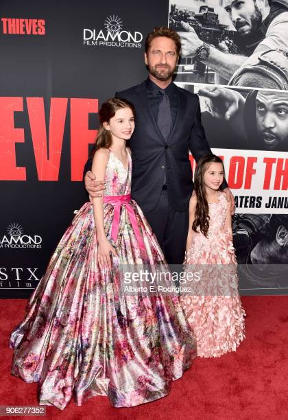Elle Whitfield Gerard Butler and Madelyn Lazar attend the premiere of STX Films' Den of Thieves at Regal LA Live Stadium 14 on January 17 2018 in Los...