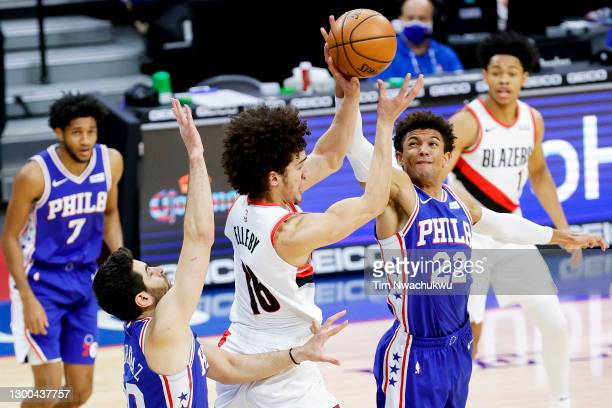 Elleby of the Portland Trail Blazers and Matisse Thybulle of the Philadelphia 76ers reach for the ball during the third quarter at Wells Fargo Center...