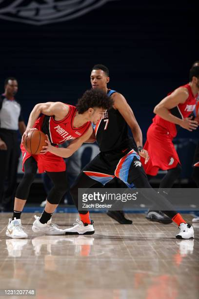 Elleby of the Portland Trail Blazers dribbles as Darius Bazley of the Oklahoma City Thunder plays defense during the game on February 16, 2021 at...