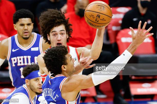 Elleby of the Portland Trail Blazers passes over Matisse Thybulle of the Philadelphia 76ers during the second quarter at Wells Fargo Center on...