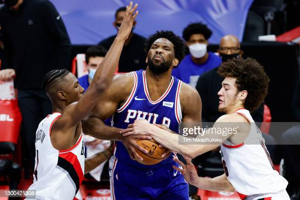 Elleby of the Portland Trail Blazers tries to strip Joel Embiid of the Philadelphia 76ers during the second quarter at Wells Fargo Center on February...
