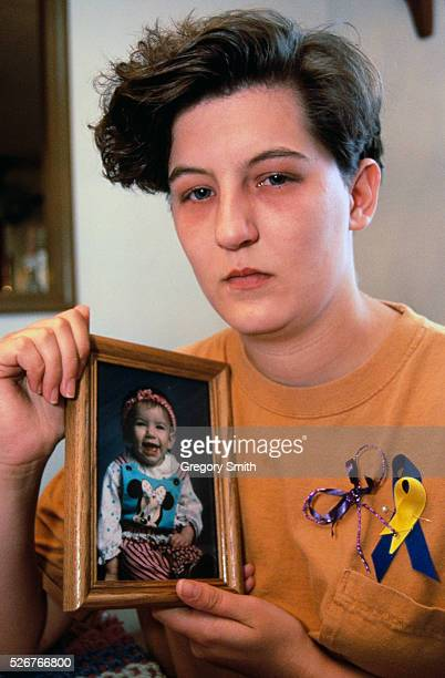 Ellen Almon holding a picture of daughter Baylee Almon killed durning the Oklahoma City federal building bombing