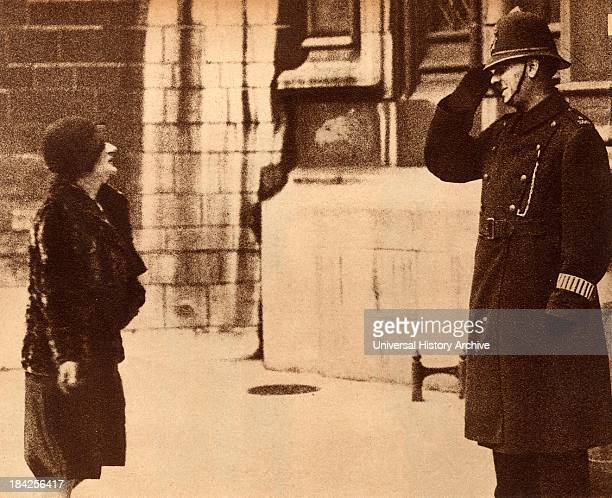 Ellen Cicely Wilkinson British Labour politician and feminist Member of Parliament for Middlesborough 19241931 being saluted by a duty police officer...