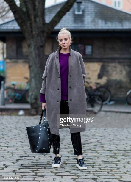 Ellen Claesson wearing a grey coat purple knit vinyl pants bucket bag at the Copenhagen Fashion Week Autumn/Winter 17 on February 1 2017 in...