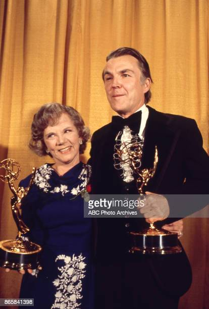 Ellen Corby and Anthony Zerbe holding their Emmy Awards in the press room at the 28th Annual Primetime Emmy Awards on May 17 1976 at The Shubert...