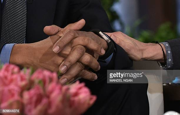 Ellen DeGeneres places her hand on the arm of US President Barack Obama while chatting during a break in the taping of The Ellen DeGeneres show at...