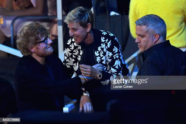 Ellen Degeneres speaks with Ed Sheeran during the 2017 MTV Video Music Awards at The Forum on August 27 2017 in Inglewood California