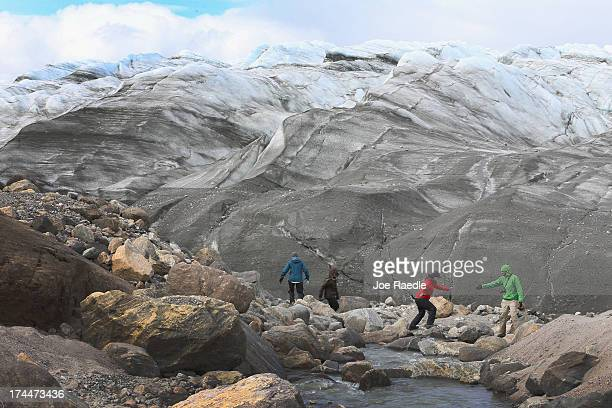 Ellen E Martin Department of Geological Sciences at the University of Florida crosses in front of a glacier as she works with her team to analyze the...