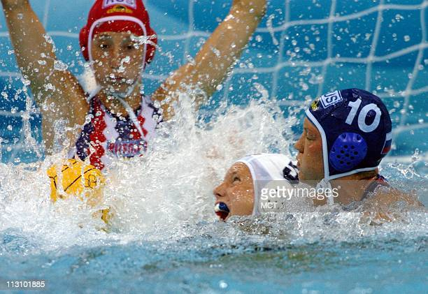 ATHENS GREECE Ellen Estes of the United States stops is fouled by Russia's Olga Turova in their water polo match on Friday August 20 2004