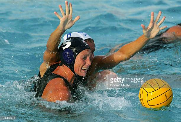Ellen Estes of the USA controls the ball in the hole as Ann Dow#9 of Canada guards during the USA's 73 win over Canada during the Women's Water Polo...