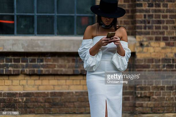 Ellen Fagan wearing a black scarf and hat and a white off shoulder dress outside Misha Collection at MercedesBenz Fashion Week Resort 17 Collections...