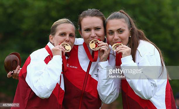 Ellen Falkner, Sian Gordon and Sophie Tolchard of England pose with their gold medals as they celebrate victory in the women's triples final match...
