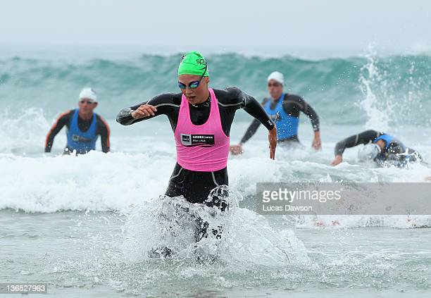 Ellen Gandy of Melbourne races up to the finishing gates on her way to winning the Open Female section of the 2012 Pier to Pub on January 7 2012 in...