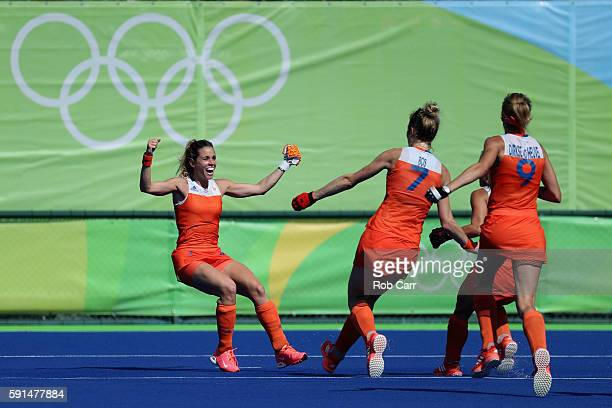 Ellen Hoog of Netherlands celebrates after scoring the game winning goal against Germany in a sudden death shootout during the women's semifinal...
