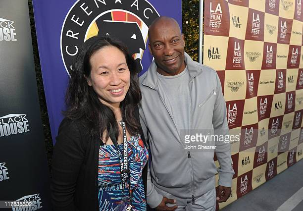 Ellen Huang and director John Singleton attends the Boyz N The Hood unofficial party during the 2011 Los Angeles Film Festival held at the Jameson...