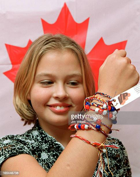 FRIEND 1 / 09/25/01 Ellen Iakovnko a Grade 8 student at Toronto's Valley Park Middle School shows off some of the thousands of friendship bracelets...