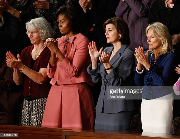 Ellen Linderman US first lady Michelle Obama Vicki Kennedy and Dr Jill Biden applaud as US President Barack Obama finishes his address to a joint...