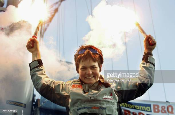 Ellen MacArthur celebrates as she arrives in to Falmouth Bay on BQ after completing her record solo round the world journey on February 8 2005 in...