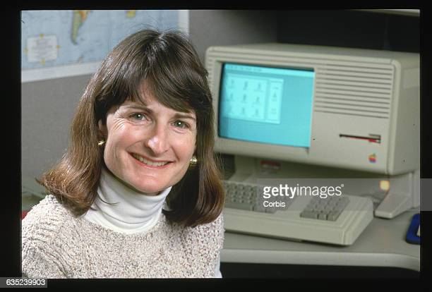 Ellen Nold manages support programs for the Apple Link program at the Apple Computer Corporation On her desk sits a Lisa the first consumeroriented...