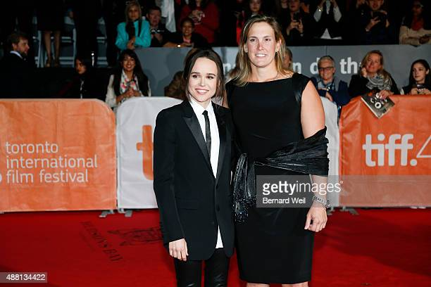 TORONTO ON SEPTEMBER 13 Ellen Page and Stacie Andree walk the red carpet at Roy Thomson Hall for the screening of Freeheld September 13 2015