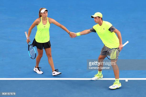 Ellen Perez of Australia and Andrew Whittington of Australia talk tactics in their third round doubles match against Timea Babos of Hungary and Rohan...