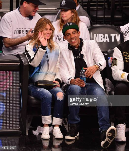 Ellen Pompeo and Chris Ivery attend the Toronto Raptors vs Brooklyn Nets game at Barclays Center on May 2 2014 in the Brooklyn borough of New York...