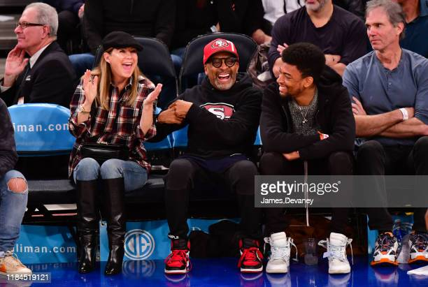 Ellen Pompeo Spike Lee and Jackson Lee attend the Brooklyn Nets v New York Knicks game at Madison Square Garden on November 24 2019 in New York City
