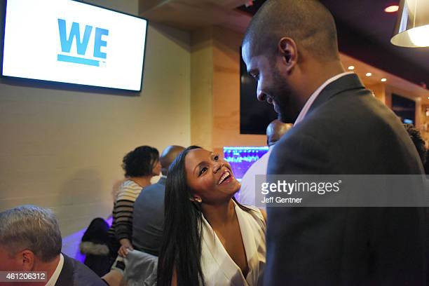Ellen Rucker Carter and Bakari Sellers of Love Thy Sister share a moment at the WE tv premiere party at Bar One on January 8 2015 in Charlotte North...