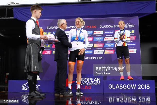 Ellen Van Dijk of the Netherlands receivs her medal from Henrik Jess Jensen Vice President of Union Européenne de Cyclisme at the podium after...