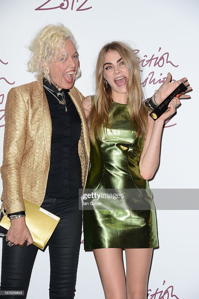 Ellen Von Unwerth and Cara Delevingne, winner of the Best Model award pose in the awards room at the British Fashion Awards 2012 at The Savoy Hotel on November 27, 2012 in London, England.