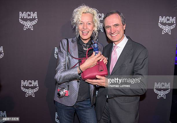 Ellen von Unwerth wearing the 'Miller Mini' bag and MCM CEO Paolo Fontanelli attend the MCM Space Odyssey Event at Frankfurt Opera Store on October...