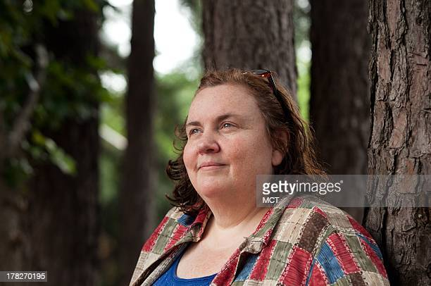 Ellen Wall who works as a nanny but is in between jobs sits in a park near her home in Duluth Georgia August 13 2013 Wall struggles with the cost of...