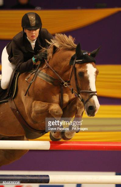 Ellen Whitaker riding Cortaflex Kanselier competes in the Dick Turpin Stakes during day three of the Horse of the Year Show at the NEC in Birmingham