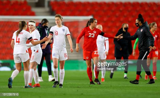 Ellen White and Georgia Stanway of England interact following the International Friendly match between England and Canada at Bet365 Stadium on April...