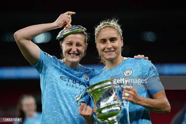 Ellen White and Steph Houghton of Manchester City celebrate with the Vitality Women's FA Cup Trophy following their team's victory in the Vitality...