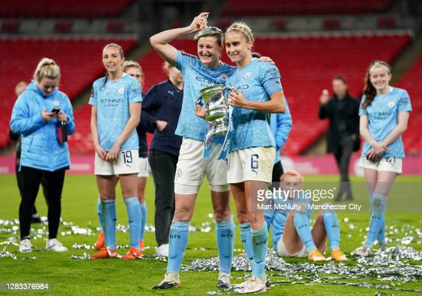 Ellen White and Steph Houghton of Manchester City celebrate with the trophy during the Vitality Women's FA Cup Final match between Everton Women and...